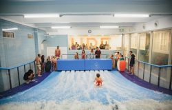 Indoor surfing in the center of Lisbon – team building & group activity